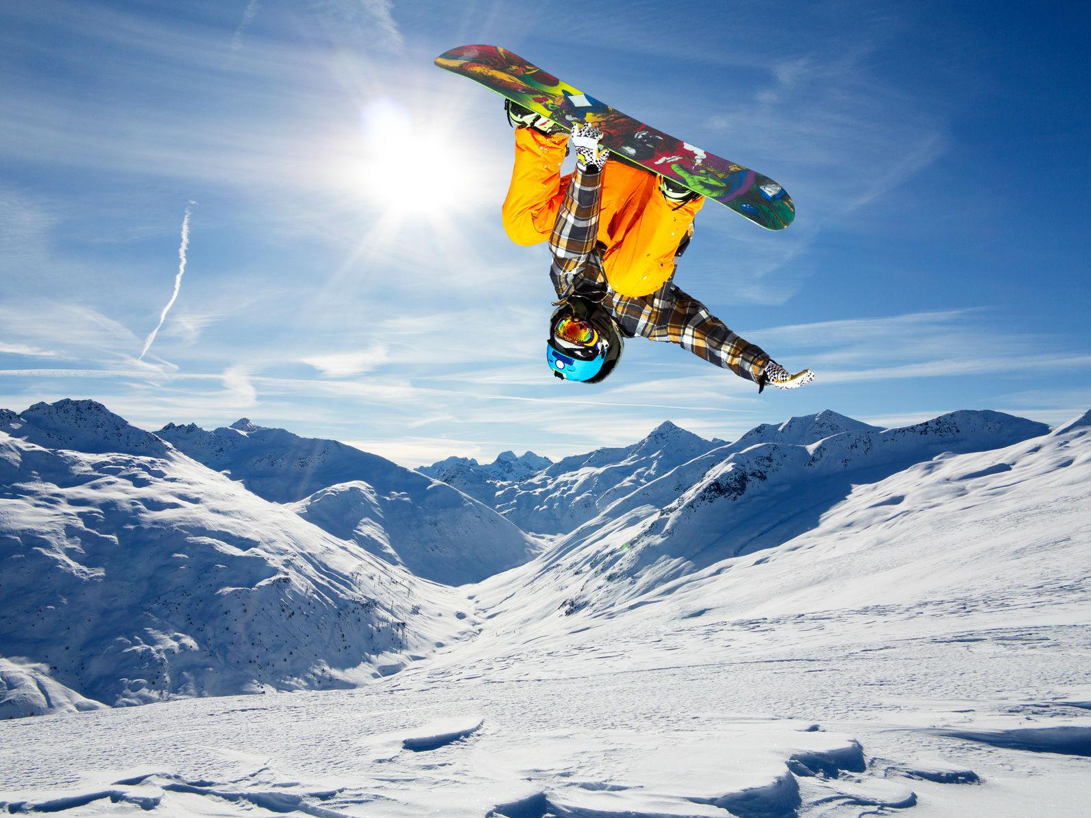 skier jumpin off pist